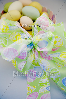 Easter Eggs In A Basket With Bow Stock Photo