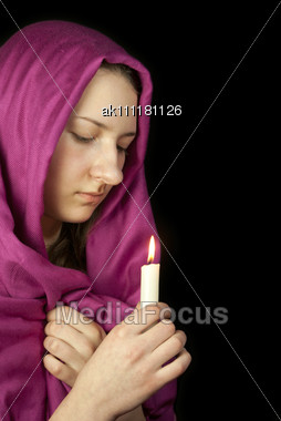Eastern Style Dressed Teen Girl With A Candle Stock Photo
