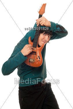 Eccentric Young Man With A Little Guitar Stock Photo