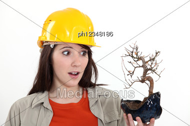 Ecologist Stood With Burnt House Plant Stock Photo