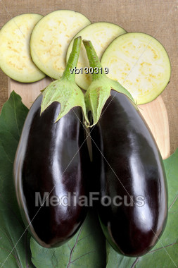 Eggplants Of Black Colour And The Cut Slices Stock Photo