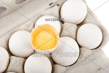 Eggs Closeup With One Egg Is Broken Stock Photo