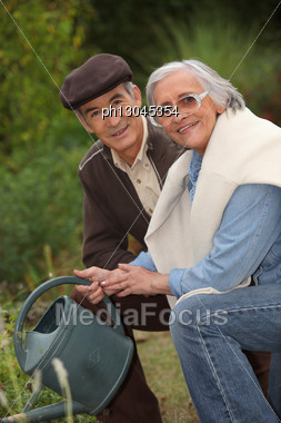 Elderly Couple Gardening Stock Photo