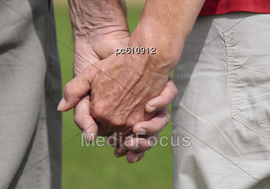 Elderly Couple, Holding Hands Stock Photo