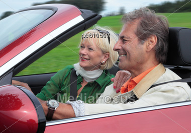 Elderly Couple In Country Drive In Convertible Stock Photo