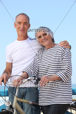 Elderly Couple Out For A Bike Ride Stock Photo