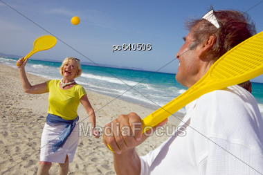 Elderly Couple Playing On The Beach Stock Photo