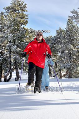Elderly Couple Skiing Stock Photo