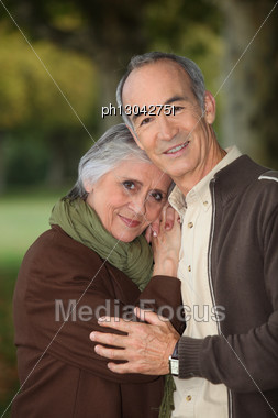 Elderly Couple Taking A Walk Stock Photo