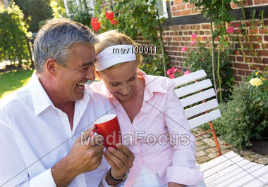 Elderly Couple Together In The Garden Stock Photo