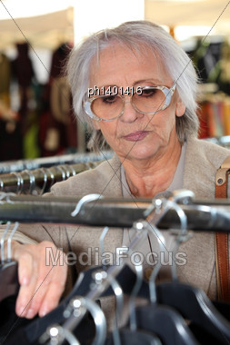 Elderly Lady Clothes Shopping Stock Photo