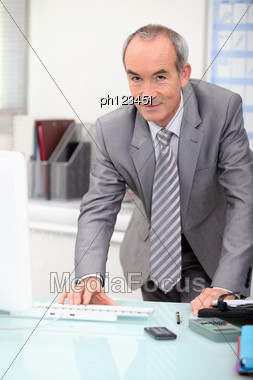Elderly Man In Office Stock Photo