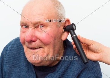 Elderly Patient With Dementia, Making Fun At The Otolaryngology During Medical Examination Stock Photo