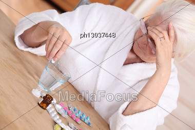 Elderly Woman With Various Medications Stock Photo