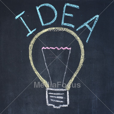 "Electric Bulb And Word ""Idea"", Chalk Drawing Stock Photo"