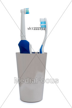 electric toothbrush and usual toothbrush isolated over white Stock Photo