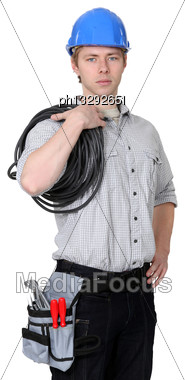 Electrician Carrying Wire Coil Stock Photo