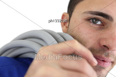 Electrician Carrying Wiring Stock Photo