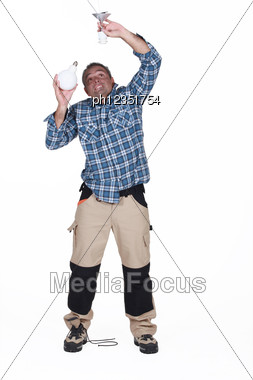 Electrician Fixing A Bulb Stock Photo