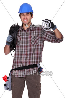 Electrician Holding A At Sign. Stock Photo