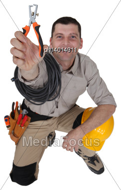 Electrician Holding A Wire Stripper Stock Photo