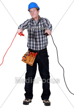 Electrician Holding Cables Stock Photo