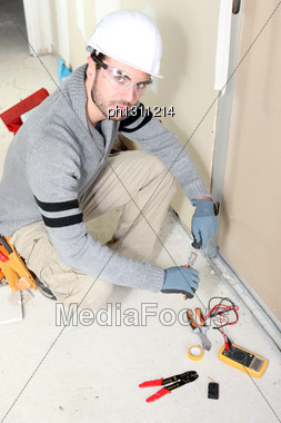 Electrician Installing Wiring Stock Photo