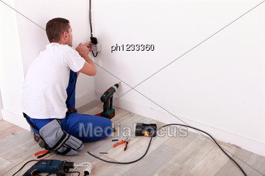 Electrician Repairing Wiring Stock Photo