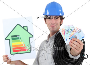 Electrician Showing Banknotes Stock Photo