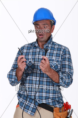 Electrician Under Shock After Explosion Stock Photo