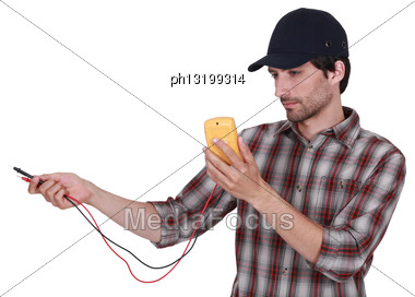Electrician With Multimeter Stock Photo