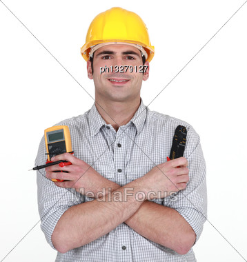 Electrician With Voltmeter And Clippers Stock Photo