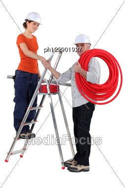 Electricians Shaking Hands Stock Photo