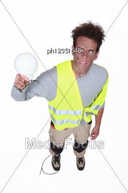 Electrocuted Man Holding A Light Bulb Stock Photo