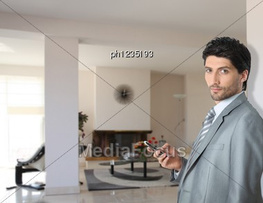 Elegant Businessman In His Fancy House Stock Photo
