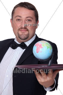 Elegant Man With Globe On A Tray Stock Photo