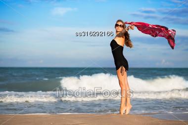 Elegant Slim Woman With Pink Pareo Posing On The Beach Stock Photo