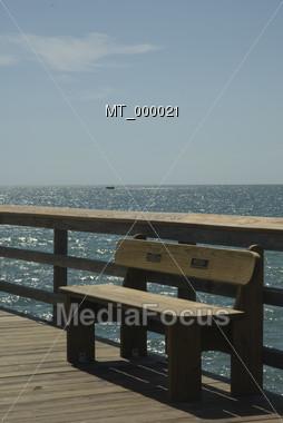 Empty Bench On Pier Stock Photo