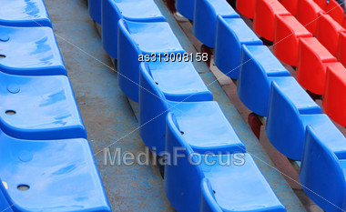 Empty Blue And Red Stadium Seats Stock Photo