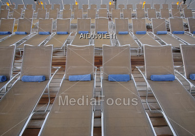 Empty Lounge Chairs On The Deck Stock Photo