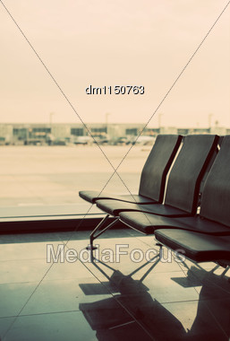 Empty Seats In Terminal Waiting Room In Airport Stock Photo