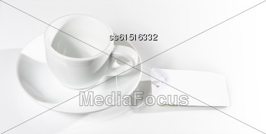 Empty White Cup And Saucer On A White Background With A Label Stock Photo