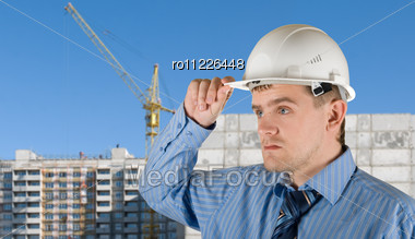 Engineer At White Helmet On Building Background Stock Photo