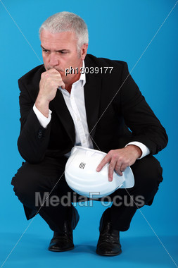 Engineer Brooding Over A Problem Stock Photo
