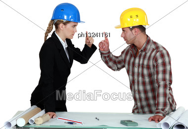 Engineer Having An Argument With A Tradesman Stock Photo