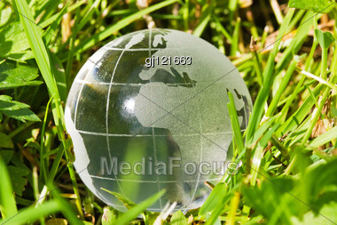 Environment Or Ecology Concept, Glass Globe In The Grass Stock Photo