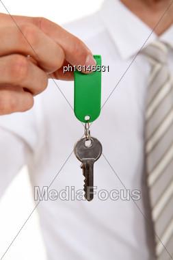 Estate Agent Holding House Key Stock Photo