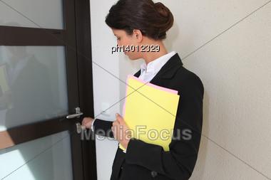 Estate Agent Opening A Door Stock Photo