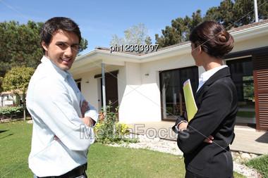 Estate-agent Outside Property Stock Photo