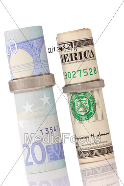Euro Currency And Dollar In A Wedding Rings Stock Photo